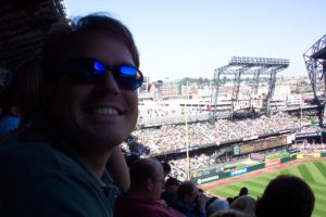 Figure 4. Jeffery Hall enjoying a Mariners game in sunny Seattle (Labor Day weekend 2003). My bro-in-law was visiting from another state, and he has made it a habit to see a baseball game in as many of our nation's stadiums as possible. We saw Ichiro Suzuki, a player now on track to reach and exceed 3,000 hits.