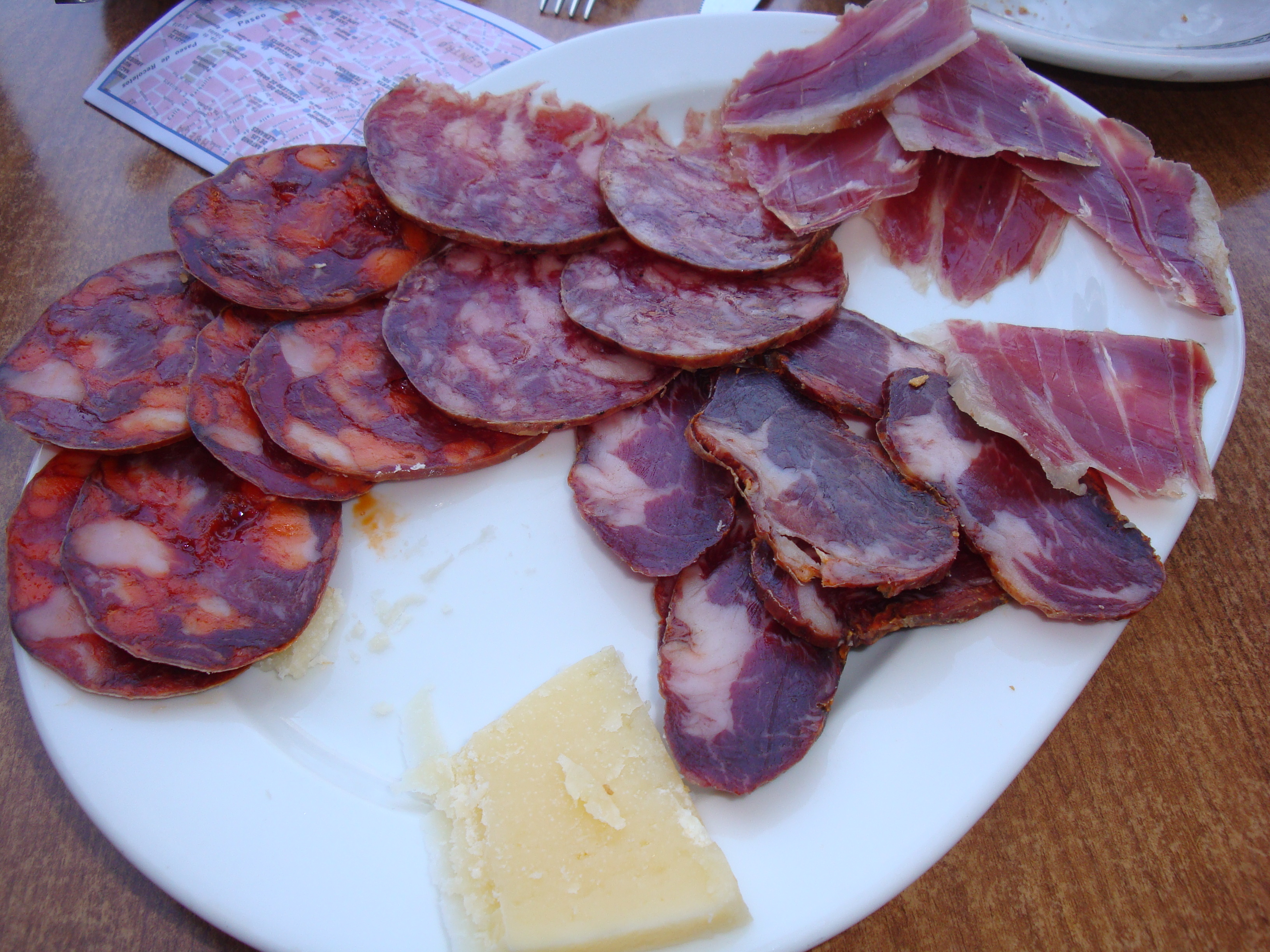 Figure 1.  A bunch of ham and manchego cheese at Plaza Mayor in Madrid, Spain (2014).